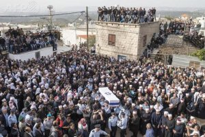 Israeli police officers carry the coffin of their colleague Zidan Saif, an Arab Druze who died after being shot during a terrorist attack in a Jerusalem synagogue.