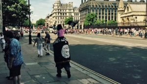 Photo shows a man draped w/ an ISIS flag, across from Parliment